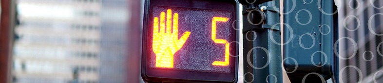 Crosswalk sign with hand showing five seconds.